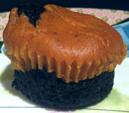 "It's a pumpkin cheesecake brownie cupcake, from reader Dina! She writes: ""Happy Halloween! I wanted to make a cupcake that used pumpkin but had a  little more texture than a regular cupcake so the pumpkin flavor didn't  get lost. It has a black chocolate brownie on the bottom and a pumpkin  cheesecake on top. It's almost like the mullet of cupcakes—business  on the top and party on the bottom! It's not the prettiest thing but it  tastes amazing."" Dina is a genius! This little monster must taste AMAZING. Also, because Laura's really nice and knows people will freak when they see there's no recipe, she suggests you try these Pumpkin Cheescake Brownies. Or come up with a recipe yourself and then email it to us and we'll publish it for the entire internet of a few hundred people to see."
