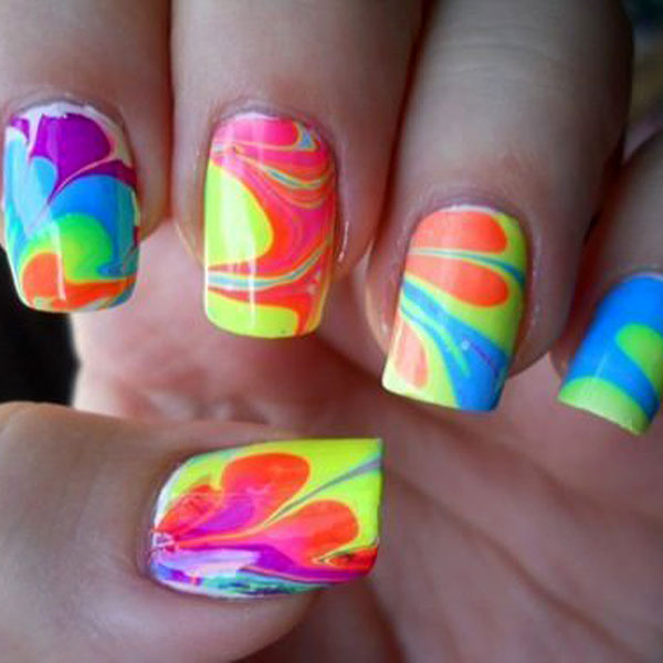 happyhues:  Check out all these fun neon nails! (Try this water marble tutorial to get the look) (via Trend: Neon Nails)
