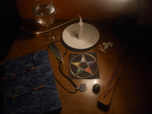 My altar with my book of shadows on the corner there. I'm in the process of adding more tools to my altar.
