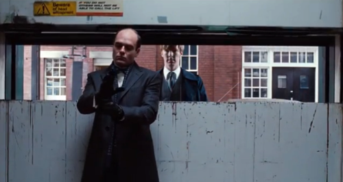 "I took this screenshot from the trailer for Tinker Tailor Soldier Spy (my review can be found here), and couldn't help giggling at the signs above the door, which read ""Beware of head entrapment"" and ""If you do not, others will not be able to call the lift."" So the worst thing about head entrapment is the fact that it inconveniences other people, is it? Or is it that it leads to bizarre Catch-22 situations in which your head is stuck so the lift won't move, but other people can't come to unstick your head, precisely because the lift won't move? My head feels entrapped just thinking about it…"