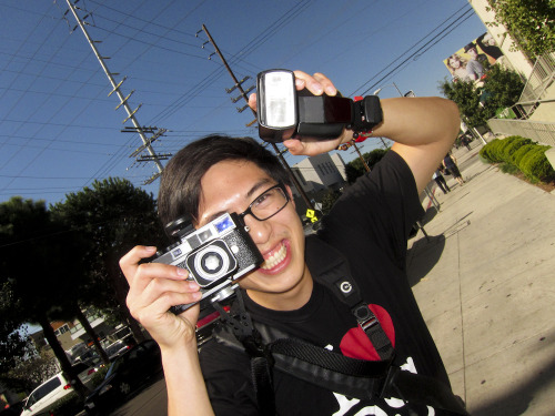 My twin brother, international street photographer, Eric Kim on Sawtelle today! Check out Eric's blog to see his amazing work and his classic videos. It's hard to believe, but Eric has almost as much enthusiasm as me!! Yep, that's a Leica M9 he's holding.  Photo by Brad Elterman