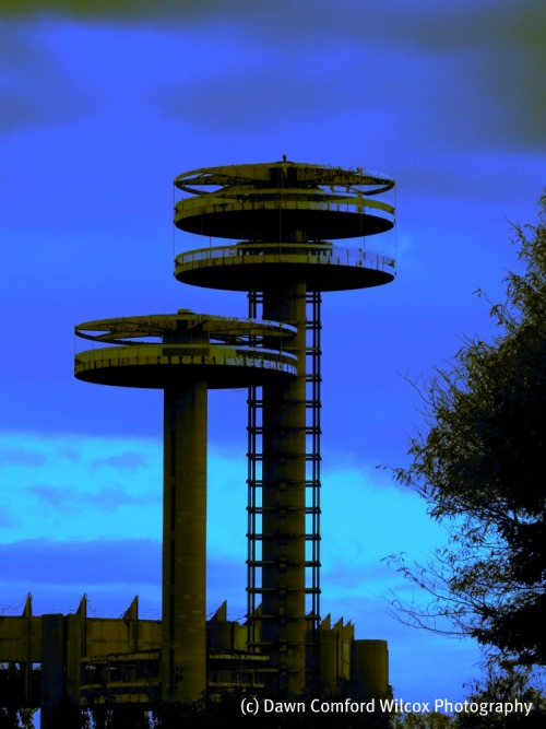 These towers were used initially New York World's Fair many years ago. Additionally, they were used as props in the movie Men in Black. Cool!
