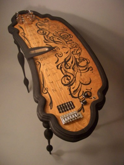This is GORGEOUS. I'm not even sure how or why you'd play it, but it's fantastic. americangothgirl:  What mad genius designed this!? sunshinegoth:  OMG IT HAS A PLANCHETTE.