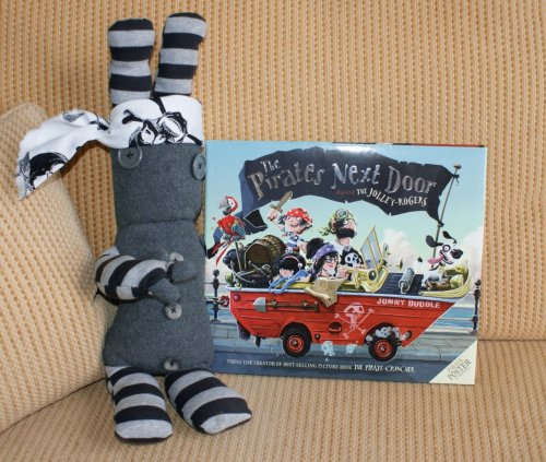 "New Picture Book!I love Jonny Duddle's work and ordered his second picture book ""The pirates next door"" the work inside is just amazing, both in skill and in humour. What I especially love about it is the little details in the background that he put in that make for a secondary action or hints.It was ""Quiggle""d approved and now we are off on our pirate ship to illustration land!"