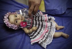 "An Iraqi infant with respiratory trouble receives medical help in a hospital following a dust storm in Baghdad, Iraq, Thursday, Oct. 13, 2011. (AP Photo/Karim Kadim) ""Once I have seen this photo I harried to my daughter, hugged her and could not stop crying"". May God help our people in Iraq. الله يساعدكوا يوبه"