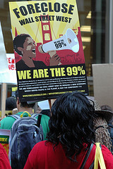 """Bowing under the high unemployment rate and a tsunami of foreclosures in  California, communities of color, are demanding debt/mortgage relief,  employment that pays a sustainable wage, an end to racist profiteering  off foreclosures and private immigrant detention center schemes. These  communities are bearing the brunt of the economic crisis with a ripple  affect finally hitting those in the middle class who once held good jobs  and nice homes but are now feeling the pain. Laurene Francois ,  of CJJC, was one of the 30 people who barricaded the entryways of Wells  Fargo. ""We came here today to demand a moratorium on all the  foreclosures that are happening, and to demand that families be kept  inside their houses. I am here as a queer woman of color, as an  organizer, as an individual, and as a Haitian daughter of first  generation Haitian immigrant parents. I am the 99%!.""  Photo by Josh Warren-White Causa Justa Just Cause @causajusta1 We are Organizing Together!"