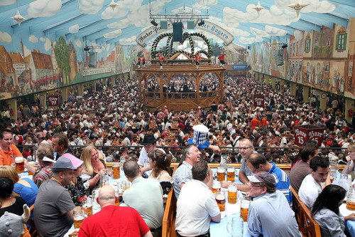 Destination > Oktoberfest Fridays are for Happy Hours and the mindless consumption of B-E-E-R. So please remember that there are entire countries and populations that celebrate beer drinking every October. Festive folks have flocked to  Germany from all parts of the globe to participate in the world's  largest annual Oktoberfest party for nearly 200 years. In addition to the  two-week celebration in Munich, the Bavarian capital where the tradition  began, Oktoberfest is enjoyed in one form or another in cities and  towns worldwide. How far would you travel to guzzle beer in a tent with 10,000 Germans? More fun Oktoberfest facts at everythingaboutgermany.com View from above by kurtw2007 on Flickr