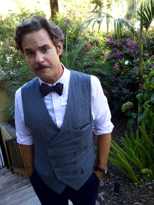 The brilliantly hilarious Paul F. Tompkins was kind enough to stop by and serve as a Guest Commentator for our DVD. For his troubles, we surprised him with one of the first Put This On bowties to come off the assembly line.* It should be mentioned that he tied the bowtie himself, without aid of mirror. A prodigy in many fields, that Tompkins. You can enjoy the comedy of Mr. Tompkins now, enjoy the DVD in a few months when they're done being manufactured, and the very-limited-edition bow ties when we launch them, November 1st. (*Put This On bowties are handmade one at a time, there is no assembly line.)