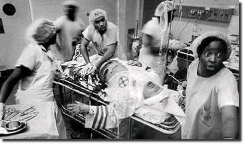 high-rollin:  duchesssx:  desertmanian:   African American doctors attempting to save the life of a Klu Klux Klan member: This photo left me speechless, this is what respect is.   this is what grace is  oh….shit..  wow…
