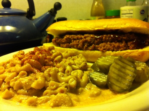 "BBQ TVP on Toasted Sourdough with a side of Vegan Baked Garlicy Mac And ""Cheese"" Finally finished all of the leftovers from the food I cooked last week so I wanted to make something new tonight. I started by making the recipe for the the mac and cheese. I added some minced garlic and used garlic salt instead of just regular. It came out a little runny and after reading the reviews on the recipe page I probably should have omitted the water. While it was baking, I started to make my own BBQ TVP mix: 7/8 cup: water 1 cup: TVP 1/2 cup: BBQ sauce (I used a sweet and spicy one) 3 tablespoon: ketchup 2 tablespoon: mustard Boil the water. Put the TVP in a bowl then pour the boiling water over it, mix and let it sit for about 5-10 minutes. Once it rehydrates, add the rest of the ingredients and mix and you'll have some awesome tasting BBQ TVP. After I took the pasta out of the oven, I put the bread in for about 4 minutes just to get the bread nice and toasty. I did add a little extra BBQ sauce on the sandwich and had some spicy, sweet pickles on the side. Overall, it was amazing and I'll be making something like this again soon!"