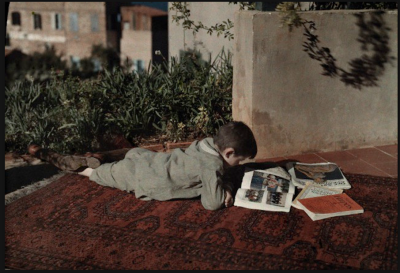 badesaba:  ca. 1927 © Maynard Owen Williams (1888-1963) Beirut - boy reading a magazine