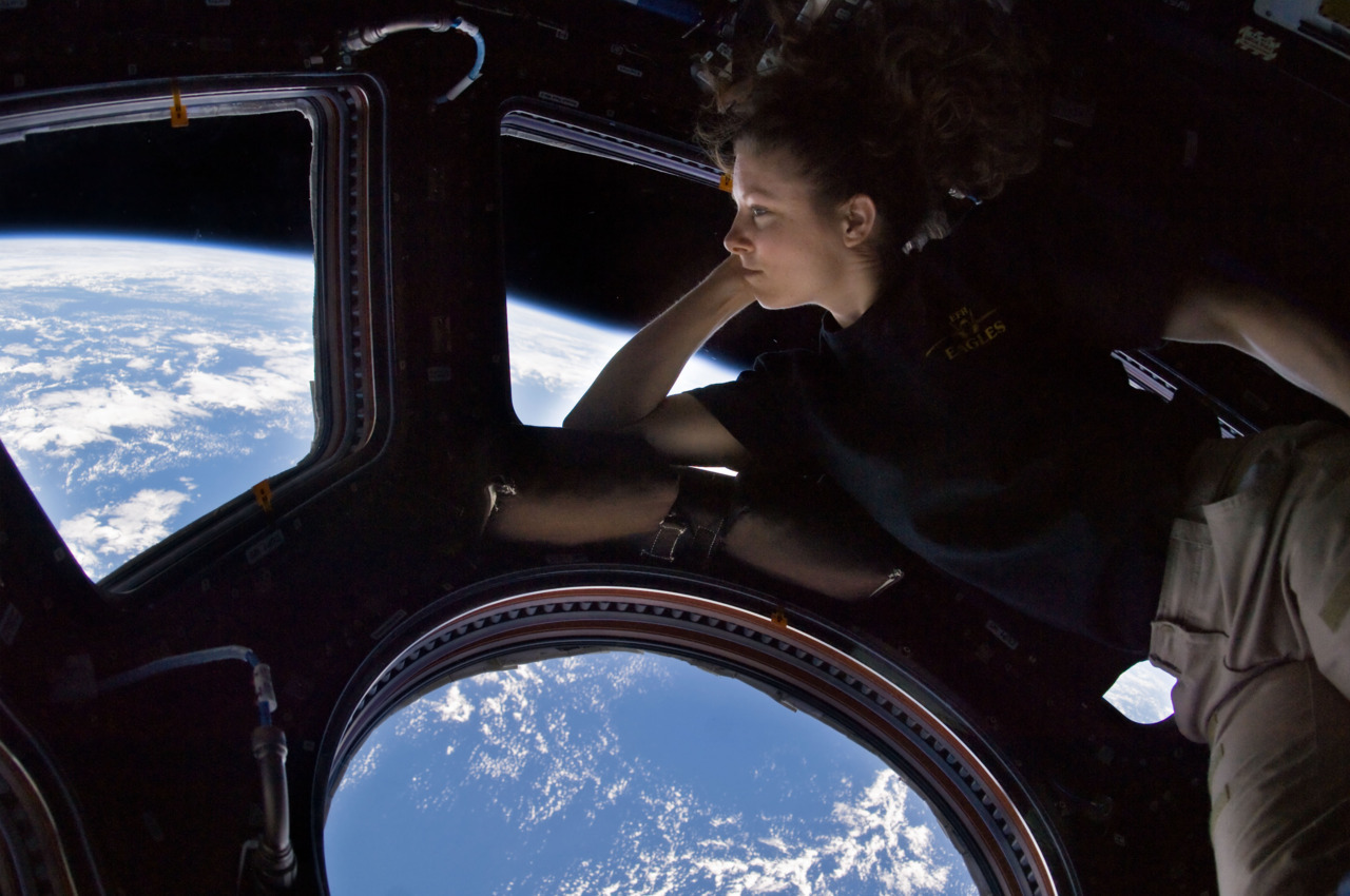 NASA Astronaut Tracy Caldwell Dyson floats 217 miles above the Earth, in the cupola of the International Space Station. This photo was taken in September of last year (image credit: NASA/Expedition 24).