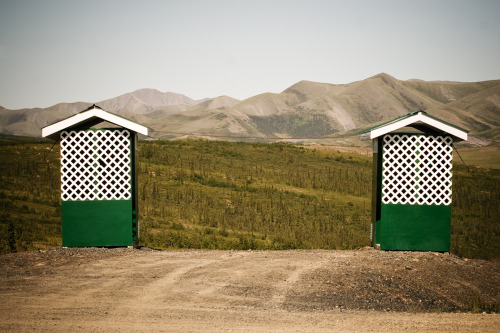 Two outhouses on the line of the Arctic Circle. ©Wylie Maercklein