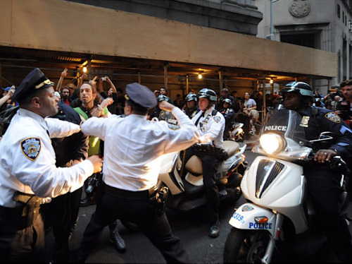 kateoplis:  Today on Wall Street: Inspector Cardona throws a punch at protester Felix Rivera.