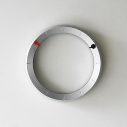 CLOCK is an ultimately simple design. A unique clock, its form has been minimised to that of a ring, making its visual impact on a wall subtle and elegant, enabling a more tasteful integration within interior environments.