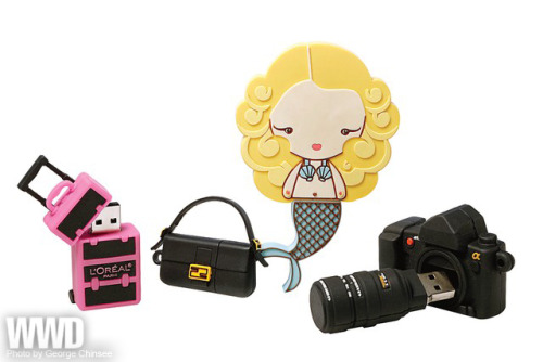 womensweardaily:  Plugged In From left: USB ports from L'Oréal, Fendi, Harajuku Lovers and Smashbox Cosmetics.  this is so cute, i really want the camera one. even though i have a canon and that's a sony, i like sony too.