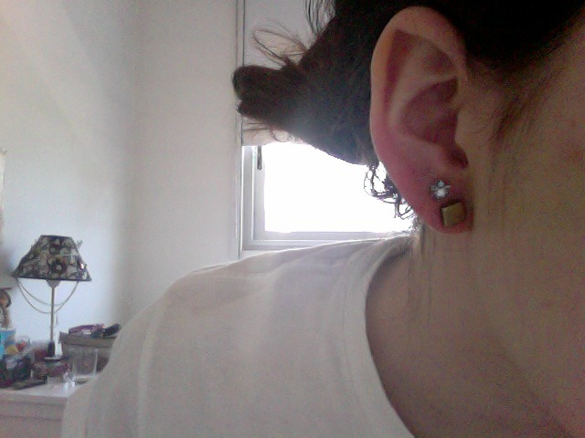 somalie:  just pierced my own ear using a needle, out of the blue i don't like the gold earrings though :( think i'm gonna buy others