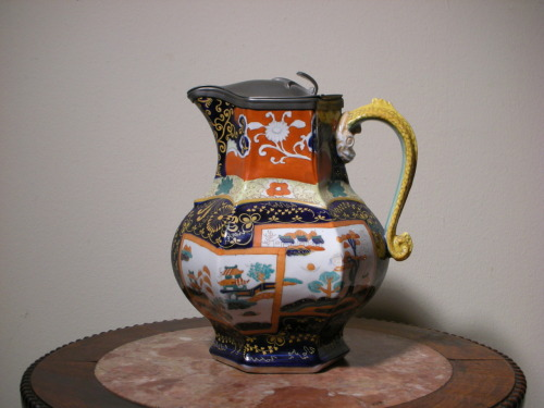 An impressive looking Masons' Hexagon Jug with Asian motif. The colors on this piece was well grouped, especially with the yellow/green Serpent Handle. Circa: 19th century.