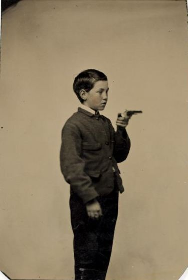 ca. 1865, [Unidentified Boy with Gun] via the International Center of Photography