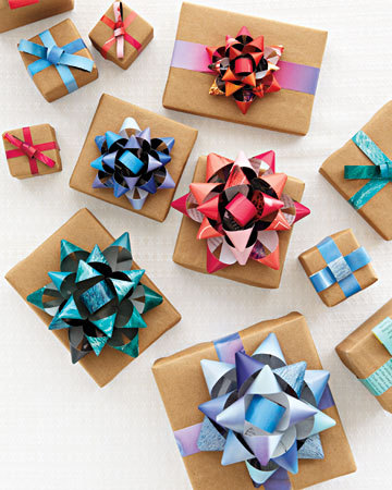 truebluemeandyou:  DIY Big Bows from Magazines. Tutorial from Whole Living here. 9 strips of magazine paper (not 63 like some of the felt flowers), cheap and super easy.