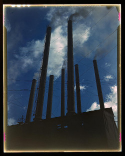 "Smoke stacks (LOC) by The Library of Congress on Flickr.Via Flickr: Palmer, Alfred T."" photographer. Smoke stacks 1942 1 transparency : color.Notes: Title from FSA or OWI agency caption. Transfer from U.S. Office of War Information, 1944.Subjects: World War, 1939-1945 Smokestacks Industrial facilitiesFormat:  Transparencies—ColorRights Info:  No known restrictions on publication.Repository:  Library of Congress, Prints and Photographs Division, Washington, D.C. 20540 USA, hdl.loc.gov/loc.pnp/pp.printPart Of:  Farm Security Administration - Office of War Information Collection 12002-28 (DLC)   93845501 General information about the FSA/OWI Color Photographs is available at hdl.loc.gov/loc.pnp/pp.fsacPersistent URL:   hdl.loc.gov/loc.pnp/fsac.1a35069Call Number:  LC-USW36-373"