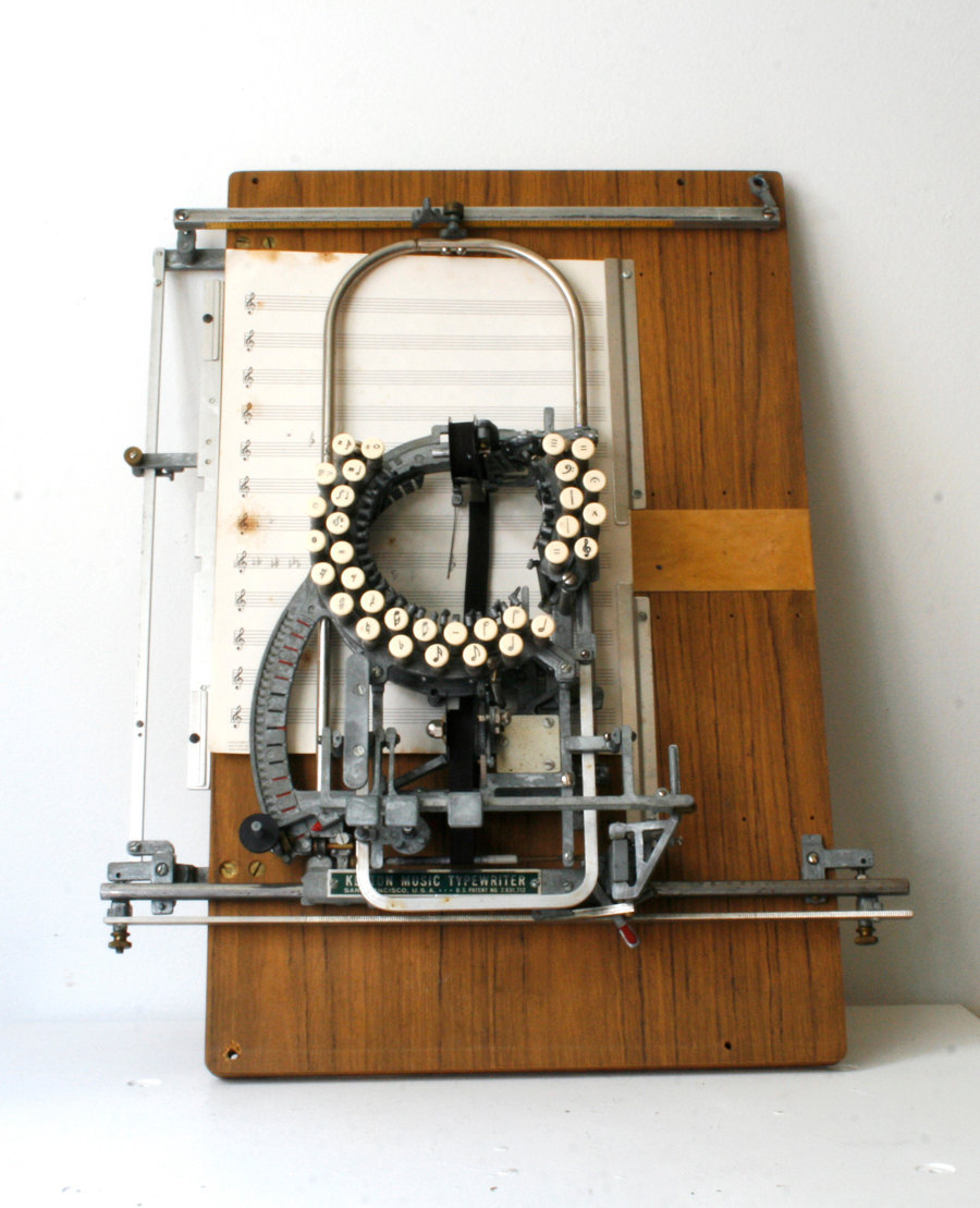 RARE Keaton Music Typewriter - Sold @ Etsy A typewriter to write musical musical notation - less than 12 are known to exist:  The Keaton Music Typewriter was first patented in 1936 (14 keys) by  Robert H. Keaton from San Francisco, California. Another patent was  taken out in 1953 (33 keys) which included improvements to the machine.  The machine types on a sheet of paper lying flat under the typing  mechanism. There are several Keaton music typewriters thought to be in  existence in museums and private collections. It was marketed in the  1950s and sold for around $225. The typewriter made it easier for  publishers, educators, and other musicians to produce music copies in  quantity. Composers, however, preferred to write the music out by hand.  More information and images can be found here