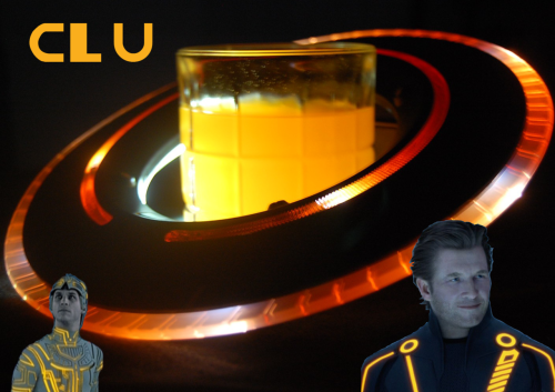"CLU (Tron Cocktail) Ingredients:1 oz Pineapple Rum 1 oz Redrum 1 oz Pineapple Juice Splash Grenadine Orange Soda Directions: Pour first 3 ingredients over ice into an old fashioned glass Fill with orange soda (I Prefer Sunkist) Splash in grenadine Enjoy EXPBarOnline will be posting one Tron themed cocktail a week, for three weeks, starting with CLU.  They explain:  CLU Was Kevin's trusted hacking program in the first TRON, and the 'benevolent' dictator in Legacy. He was a pivotal part of both films, ad was a freaky robot faced Jeff Bridges in legacy. This cocktail is fruity, smooth, sweet, and will keep you refreshed for many cycles.  ""Out there is a new world! Out there is our victory! Out there is our destiny!"" - CLU Drink created and photographed by our friends at EXPBarOnline."