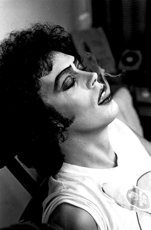 Tim Curry blowing smoke on the set of 'The Rocky Horror Picture Show', 1975.