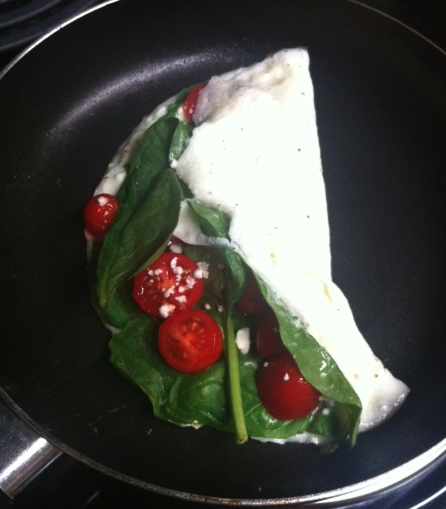 Breakfast! 2 egg whites, 2 TPS of feta cheese, spinach and cherry tomatoes! I love these omelets in the morning. They are a perfect blend of protein in the mornings!