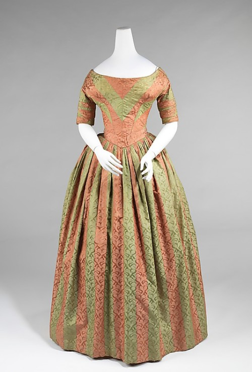 omgthatdress:  Evening dress ca. 1840 via The Costume Institute of the Metropolitan Museum of Art  I've been thinking about starting a feature that pairs fashion plates with extant gowns, and I couldn't resist this opportunity!  Obviously she's covering her bodice with her shawl, but I have to think it looks a little bit like this!