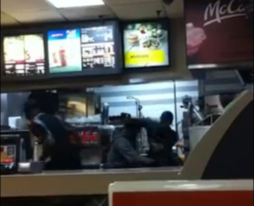 "rabblevolunteer:  shortformblog:  Brutal incident at NYC McDonald's: Self-defense or unchecked violence? There is video of this on YouTube. We're linking it instead of posting it, because it's that violent and difficult to watch. Here's what happened: Two customers got unruly after a McDonald's employee wouldn't give them their food until he could check the $50 bill they handed over. The customers started slapping him, and then jumped over the counter to confront him. What these unruly customers didn't know is that the employee, Rayon McIntosh, recently got out of jail for manslaughter, and the incident set him off. He got a hold of a metal pole and started beating them savagely. One of the customers suffered a broken arm and fractured skull. The result? Both the customers and McIntosh got charged, in McIntosh's case with felony assault. The chain and franchise owner have both come out against McIntosh's actions, but the video itself seems to support a reasonable cause for self-defense, even if McIntosh's own reaction was too heavy-handed (to put it lightly). Watch the video and see what you think. source Follow ShortFormBlog  This is…shocking. Not just the violence but the two customers' behavior is just mind-boggling to me. How you can honestly walk into a restaurant and feel like it's appropriate to not only hit/slap someone but call them names like ""pussy"" and ""fucker"" and then jump behind the counter to continue harassing the person serving you and not expect them to defend themselves? All over a goddamn Big Mac?  Heavy handed? I work retail, I've worked fast food… Any fast food worker who'll send a guy to the hospital in an ambulance, rather than to the morgue in a moist squishy pile, is showing an amazing level of restraint."
