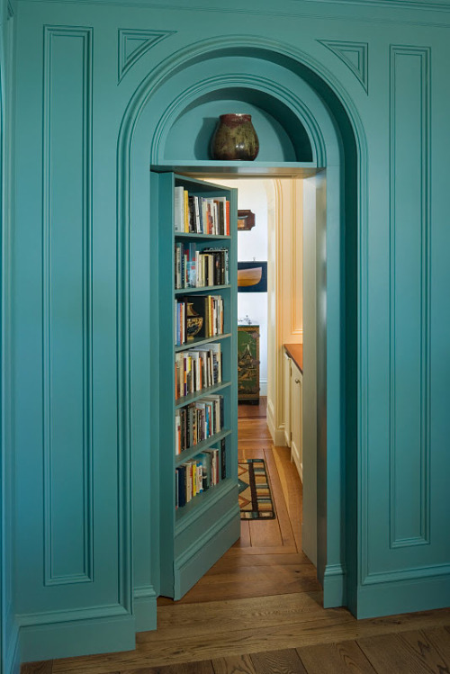 A bookshelf doubles as a beautiful arched secret library door (via COCOCOZY: CLASSICISM WITH A TWIST - THE HOMES ARCHITECT PETER PENNOYER BUILT!)