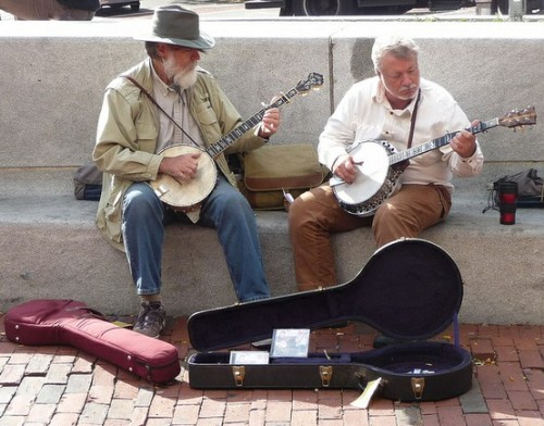 Strummin' in Harvard Square on a sunny Saturday afternoon in Cambridge, Massachusetts. (photo by Charles Cherney)