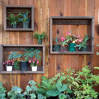 "wallacegardens:  A garden fence with built-in window ""frames"" made from scrap wood, to display window-sill-size container plants."