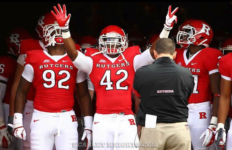Rutgers University Linebacker Steve Beauharnais exiting the tunnel before the RU - Navy game.  He's honoring Eric LeGrand by holding up 5 fingers and 2 fingers, for LeGrand's number 52.