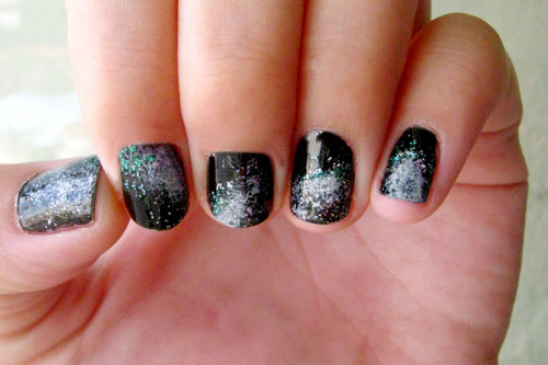 The first attempt at galaxy nails. After the black polish, I sponged on some white, followed by purple glitter on the sides of the whites, and topped off with dashes of green and silver glitter.