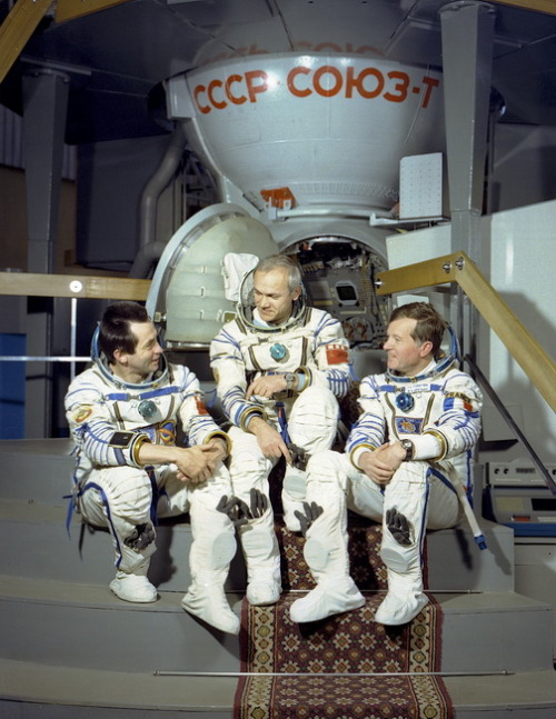 Aleksandr Ivanchenkov, Vladimir Dzhanibekov and Jean-Loup Chrétien in front of the Soyuz simulator in preparation for their Soyuz T-6 flight. (1982)