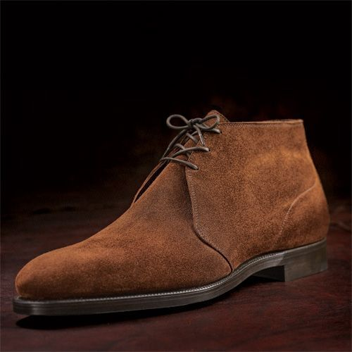 "Q and Answer: How Should You Protect Your Suede Shoes? Brett writes to ask: I have a pair of suede plain-toe bluchers coming from Alden.  What do you do, if anything, for protection or treatment? Some  people think suede shoes are too delicate and need  babying, but in  actuality, if you know how to take care of them, they're easier to  maintain than regular calf. You don't have to  condition, polish, or wax them every couple of weeks, after all. Here are some basic  maintenance tips: Apply a waterproofing spray to protect them from stains and    water. Brush with a suede brush before and after the spray. I    use Allen Edmonds' spray protectors and brushes. If you get a stain, use a suede eraser. Again, I use Allen Edmonds'.  If you get mud on them, let the mud dry overnight and brush it off    with a stiff brush (eg a nail brush). If there is some remainder dirt left,  wipe it off with a clean, damp cloth or use the suede eraser.  In most cases, if your shoes get wet, they should be fine. In some   cases, however, they can be left with water stains. It  may sound   counter-intuitive, but in those situations, I recommend  you wash your   shoes, like this. If your stains are more serious, such as those from oil or grease,    you may be in trouble. Try brushing it off with a stiff brush and    applying the suede eraser. If those don't work, hand wash them. A   last ditch attempt could be to just take them to a cobbler for a   professional cleaning. If all those fail, you'll have to either tell   yourself the stain is a ""patina"" or resign your shoes.   If your suede shoes are old, hold them over a pot of  boiling water and let the steam hit it. After that, brush them with a  suede brush. This should restore the material's nap and luminescence.  The above  should be done in addition to all the other things you  should be doing  for your shoes: Insert unvarnished, cedar shoe trees  whenever you're not  wearing your shoes; let them have at least a day of  rest in between  each wearing; and use shoe horns when you can.  Don't be afraid to wear them in more inclement weather,  either. I     personally  wouldn't recommend wearing them at the end of winter, when     there is a  bunch of half-melted, dirty, slushy snow outside, but  almost  any   other time is  fine. I wear mine more or less year round. In the end, remember: shoes are meant to be worn. There's a   difference between aging well and aging poorly, but your shoes are   always going to age. If you invest in quality shoes and do the above,  they'll age well and actually look better than they did when they were  brand new."