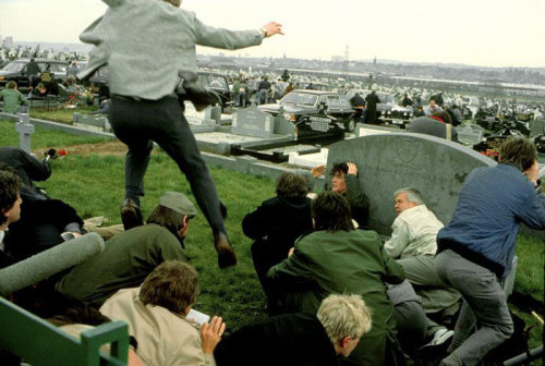 "© Chris Steele-Perkins, 1988, West Belfast / Northern Ireland Mourners at a Republican funeral flee for cover as they are attacked by Protestant fanatic Michael Stone at the Milltown cemetery. ""There is no objectivity and you've got to react as a human being to what's in front of you. If you cease to do that, you cease to be any good."" (Chris Steele-Perkins) » find more of Magnum Photos here « 