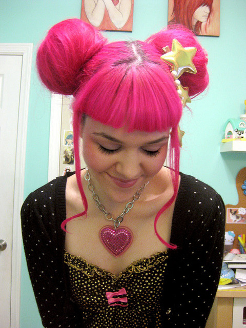 qualityhair:  hair buns by San Smith on Flickr.  Amazing pink hair and she's supporting a Tarina Tarantino heart necklace.