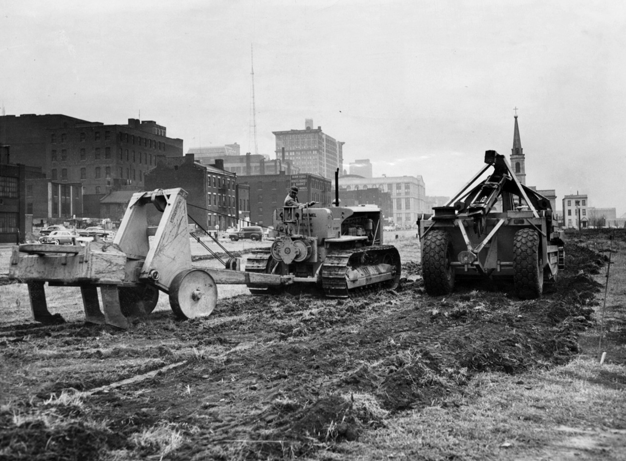 Construction workers begin grading downtown for the Third Street Highway, known as the Interregional, in November 1952. This scene looks north from Third and Spruce streets. It was the first major highway project in St. Louis after World War II. When completed three years later, it ran only 2.3 miles from Washington Avenue at Eads Bridge, south to Gravois Avenue at 12th (now Tucker) Boulevard. By then, the state Highway Commission already was planning much bigger things. Barely a decade later, the Interregional became the path for Interstate 55 into downtown, but it gave relief to motorists trying to get in and out of downtown, and it gave them a taste for speedier superhighways. (Lester Linck/Post-Dispatch) See more photos »
