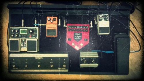 This is my pedal set-up.  Boss TU-2 Tuner Jekyll & Hyde Ultimate Overdrive Boss DS-1 Distortion Boss DD-20 Giga Delay Dunlop Crybaby Wah Fender Channel Switcher/Gain Boost (The Mesa footswitch is for my old Dual Rectifier that I sold)  I'm looking to add a compression pedal sometime in the future, but food is more important. :)