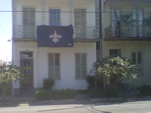 Bought a rather modest Saints flag to hang from the balcony on game day. WHO DAT!!!