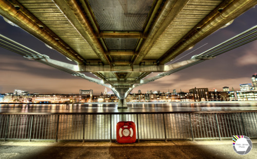 lushlondon:    Under the Bridge The name of this photo lends itself to the wonderful Red Hot Chili Peppers. An interesting fact for you, well perhaps not interesting but a fact nonetheless, They were the first band that I ever saw in concert. Hyde Park in 2001. Anyway enough of my rambling. This shot was taken from under the Millennium Bridge. I think it shows the structure well and I haven't seen any shots that I can recall from this position. If you have one please post it in the replies.