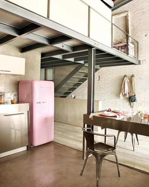 Good mix of industrial elements vs older rustic qualities such as the brick wall and iconic Smeg fridge.