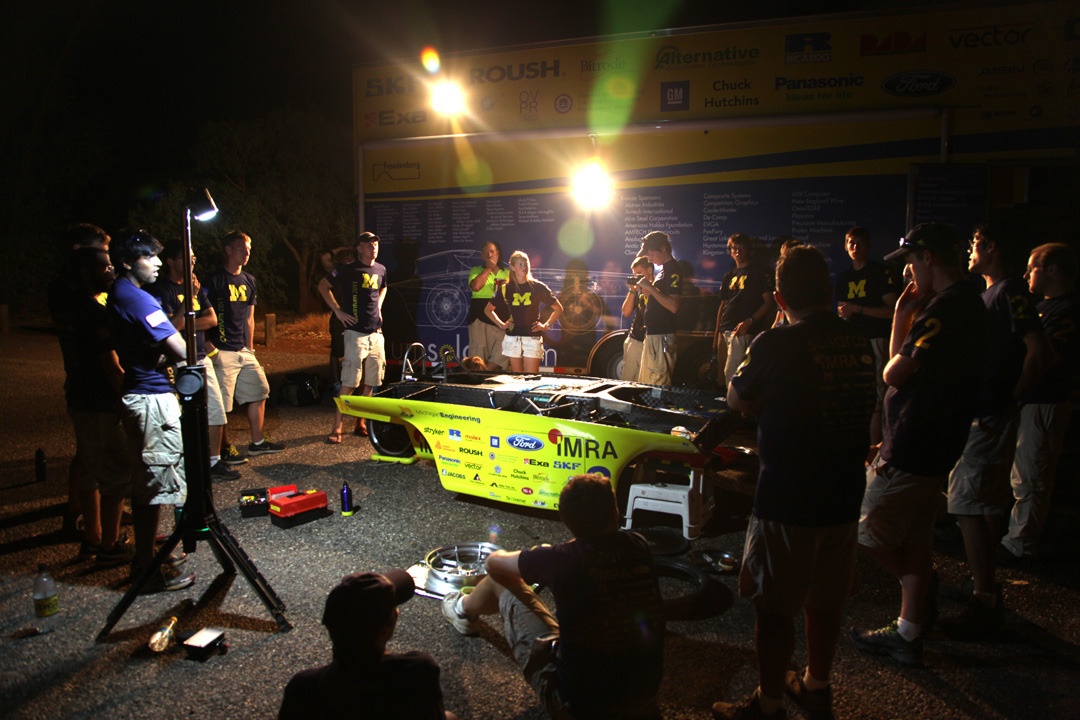 U-M solar car team meets for a late night meeting to go over the events of the day and the strategy for tomorrow at the end of the first day  of  the World Solar Challenge competition on Sunday, October 16th, 2011 Photo by Marcin Szczepanski, Multimedia Content Producer/College of Engineering, U-M