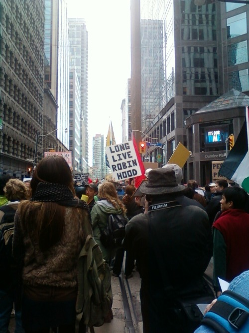"Welcome to the Occupation: Toronto Occupiers on the march, Saturday, October 15, 2011. Note the digital sign on the right which reads ""It's our time."" Tweet"