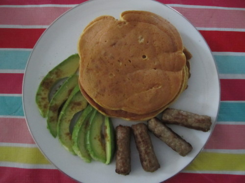 Weekend Brunch Homemade Pumpkin Walnut Pancakes Sausage Links Half Avocado sprinkled with Ground Cumin, Garlic Salt, and Lemon