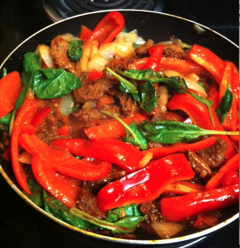 Vegetarian Fajitas! I have a thing for having very VERY colorful foods! I think it adds to the whole experience of it! In this: 2 Red Bell Peppers 1 Large Yellow Onion 1 Handfull of spinach  1 Cup of Morning Star Steak Starters 1 Packet of Fajita Mix 2 TBS of EVOO Throw it all together. Get yummy deliciousness!