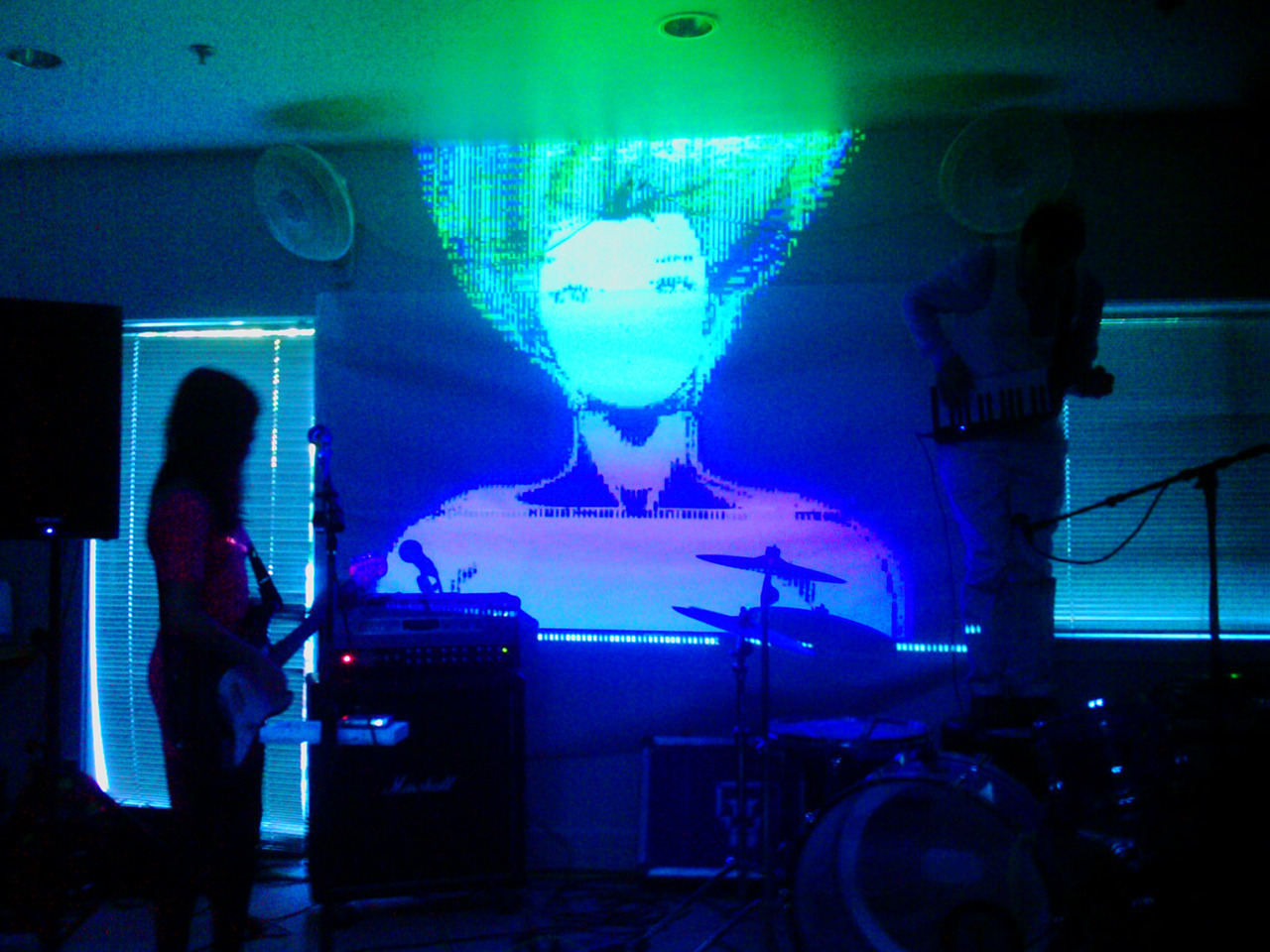 The Glowing Stars performing with me doing visuals. On the right jamming on his drum stool is Matt who organized the Pulsewave SF event at the East Bay Mini Maker Faire. He did a great job pulling it off.